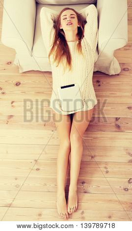 Beautiful caucasian woman sitting on the floor with tablet.