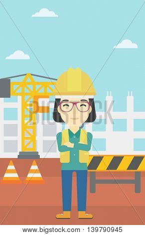 An asian female builder with arms crossed. Confident builder on a background of construction site. Builder in helmet on background of road works. Vector flat design illustration. Vertical layout.