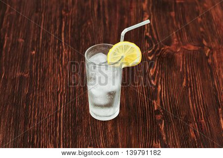 Glass Of Fresh Lemonade With Ice, Cocktail On Wooden Background