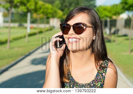 Close-up Of Smiling Attractive Girl Talking At Telephone