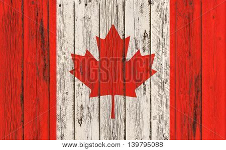Flag of Canada painted on wooden frame