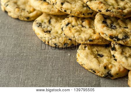 Crispy cookies with olives rosemary and cheese on napkin