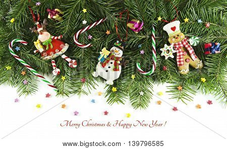 Horizontal Christmas card with traditional decorations and funny figurines of snowman, reindeer and gingerbread man on background of natural conifer background, isolated on white, with sample text.