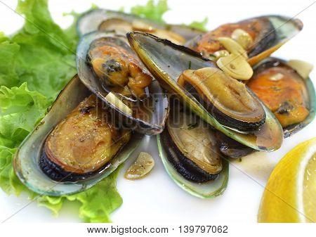 Delicatessen dish, oysters in vinegar with garlic