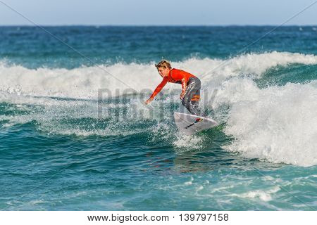 Sydney Australia - November 26 2014: A Australian young surfer on the wave Bondi Beach in the Eastern Suburbs Sydney New South Wales Australia.