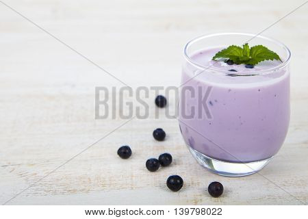 Smoothie With Blueberries On A Wooden Table
