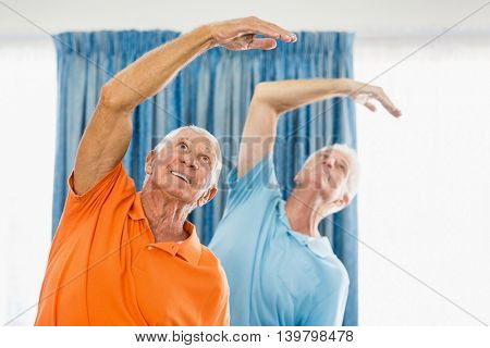 Senior men doing exercises at a studio