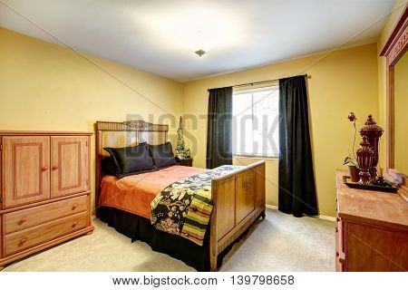 Bright Yellow Bedroom With Carved Wood Furniture