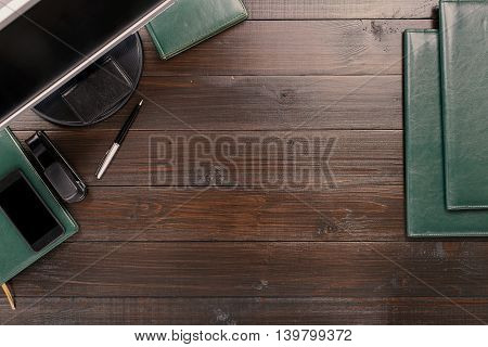 Office Desktop With Copy Space. Notebook Pen Monitor Leather Folders Stapler And Smartphone With Blank Screen On A Wooden Office Desk. Top View