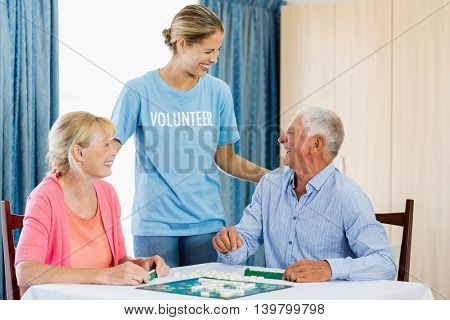 Senior couple playing board games in a retirement home