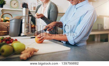 Women At Bar Counter Preparing Juice