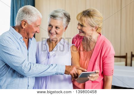 Seniors pointing on smartphone