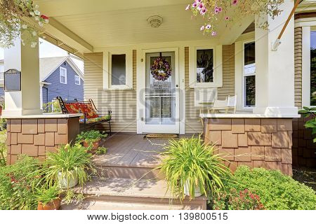 Cozy Covered Porch With White Columns In American Craftsman House