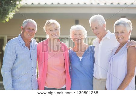 Seniors standing together outside the retirement home