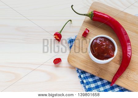 Tomato Sauce Salsa, Hot Chili On Wooden Background.