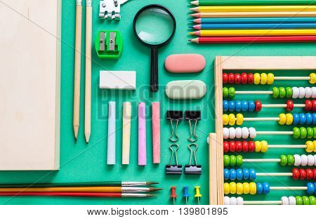 back to school concept related items on green background