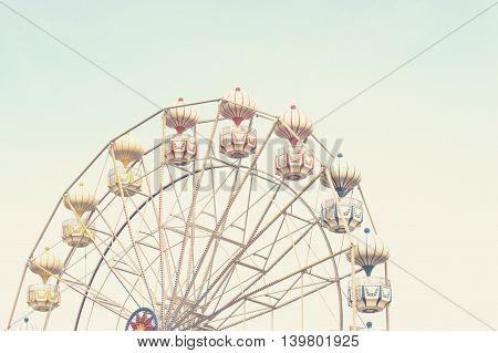 ferris wheel against blue sky, vintage filter effects