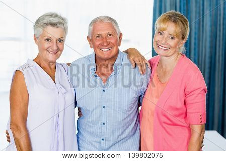 Seniors standing together in a retirement home