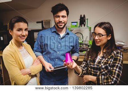 Portrait of graphic designers standing in office