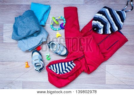baby winter clothing concept autumn sneakers caps toys. how to dress baby in winter choose shoes