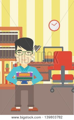An asian young student holding pile of books. Man with pile of books in hands at home. Smiling student with stack of books. Vector flat design illustration. Vertical layout.