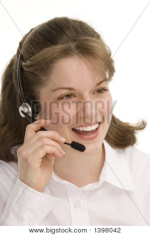 Female Operator Smiling Holding Mic On Head Set