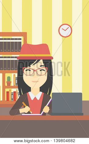 An asian young female student sitting at the desk with laptop. Student using laptop at home and writing notes. Student working on laptop. Vector flat design illustration. Vertical layout.
