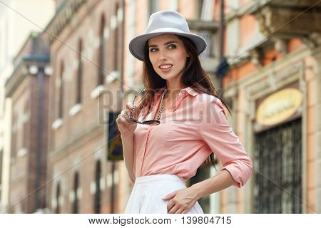 Fashionably dressed woman on the streets of a small Italian town