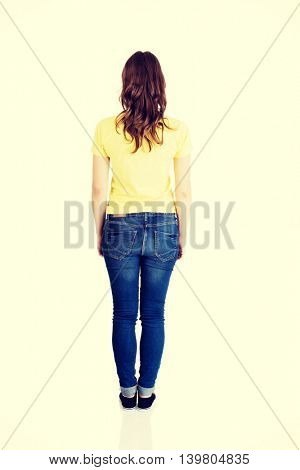 Attractive standing woman. Back view.