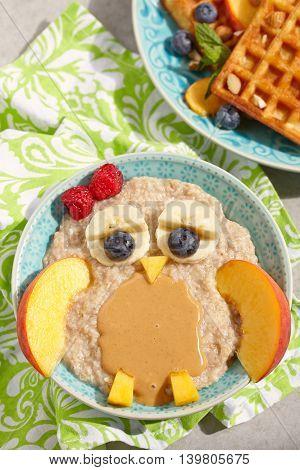 Kids breakfast porridge with fruits and berries