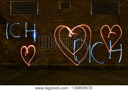 Declaration of love with light at night outdoor with german words for i love you