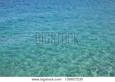 Transparent sea water of the Mediterranean Sea for a beautiful natural background.