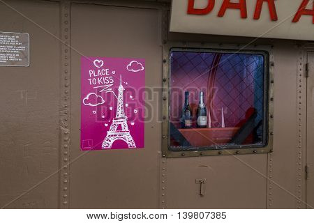 PARIS, FRANCE - MAY 12, 2015: This is the top observation deck of the Eiffel Tower as a place for love romance.