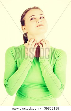 Attractive woman scratching her neck.