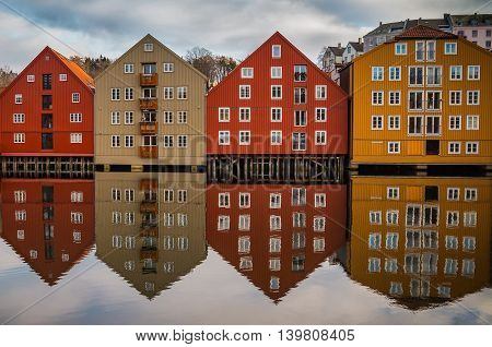 Symmetric reflection of pld houses in Trondheim Norway