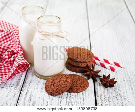 Oatmeal Cookies And Bottles Of Milk