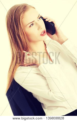 Business woman is talking through phone.