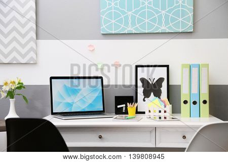 Stylish workplace with laptop at home