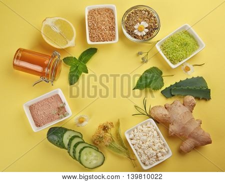 Frame of natural ingredients for skin care on yellow background