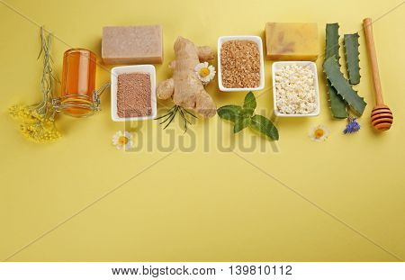 Natural ingredients for skin care on yellow background
