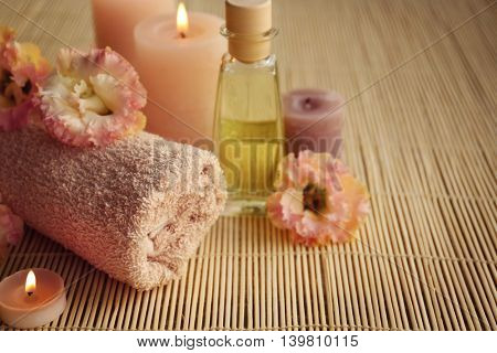 Beautiful spa composition with flowers on mat