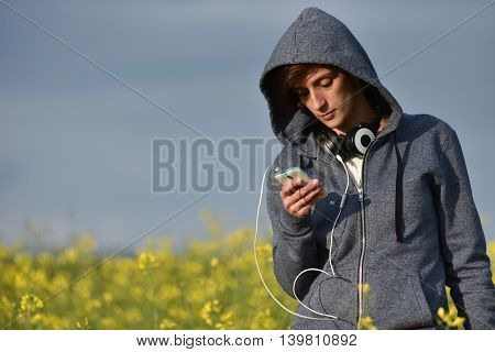 Woman Using Smart Phone In The Outdoors