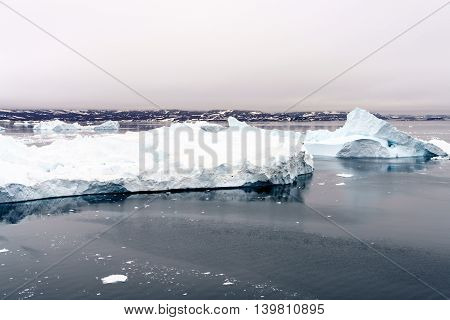 Icebergs are on the Arctic Ocean at Ilulissat fjord, Greenland