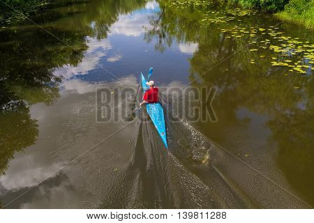 Man on the river training in kayaking. Sport