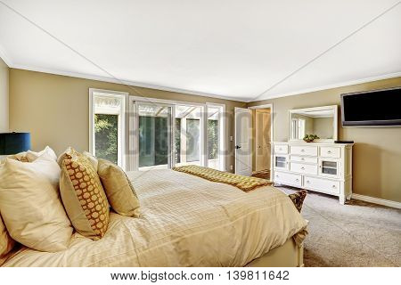 Master Bedroom With Double Bed And White Vanity Cabinet.