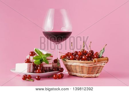 Cherry Homemade Liquor In A Glasses On Pink Background And Cherries