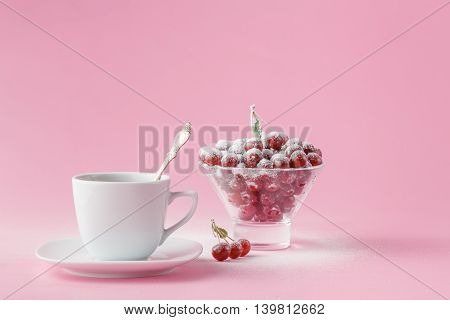 Wild Cherry In A Plate With A Mug Of Coffee On A Pink