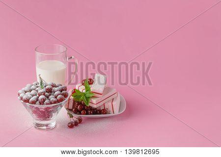 Glass Of Milk And Wild Cherry With Sugar Powder