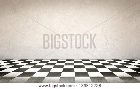 Concrete wall and checkerboard floor for display