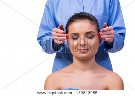 Beautiful young woman during face massage session
